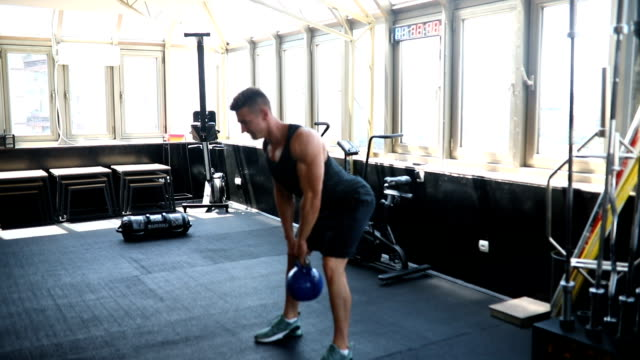kettlebell swing - swinging stock videos & royalty-free footage