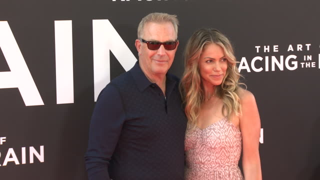 stockvideo's en b-roll-footage met kevin costner and christine baumgartner at the the art of racing in the rain premiere on august 01 2019 in hollywood california - kevin costner