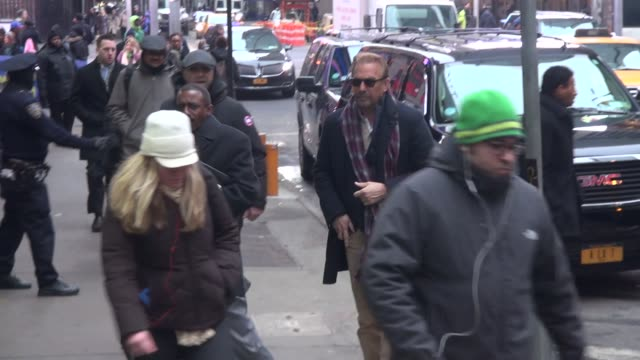 stockvideo's en b-roll-footage met kevin costner arrives at the good morning america show and signs for fans at celebrity sightings in new york on february 12 2015 in new york city - kevin costner