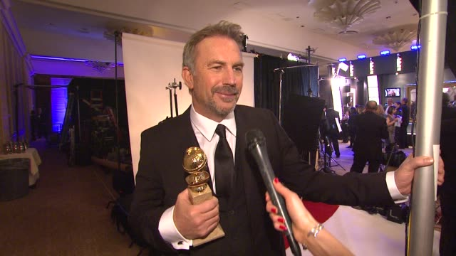 stockvideo's en b-roll-footage met interview kevin costner on the popularity of 'hatfields and mccoys' and on the difference between a miniseries and a film at the 70th annual golden... - kevin costner