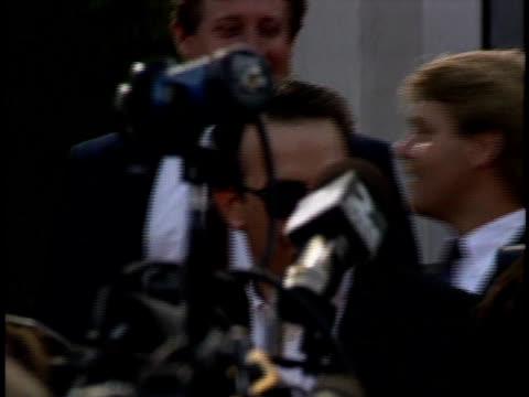 Kevin Costner walking through crowd toward Fox Westwood Theatre