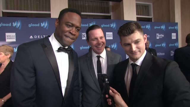vídeos de stock e filmes b-roll de interview kevin daniels kevin bigley and michael mosley on their series 'sirens' on being at the event and on the homophobic storyline on 'empire' at... - the beverly hilton hotel