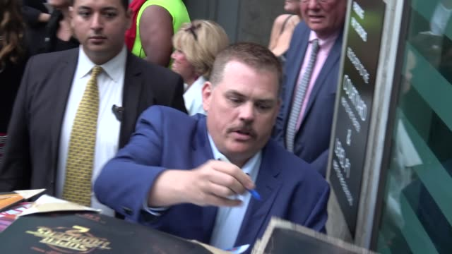 kevin heffernan signs for fans at the super troopers 2 premiere at arclight cinemas in hollywood in celebrity sightings in los angeles - super troopers 2 stock videos & royalty-free footage