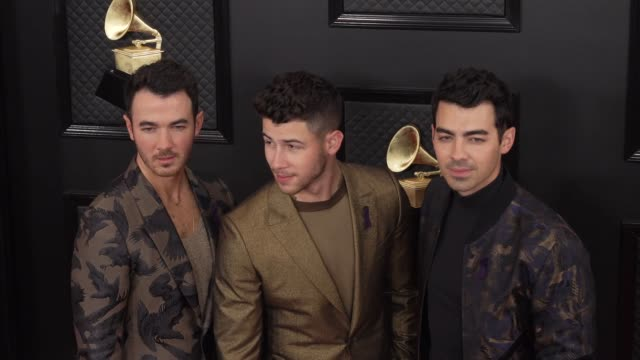 kevin jonas, nick jonas, and joe jonas at the 62nd annual grammy awards - arrivals at staples center on january 26, 2020 in los angeles, california. - grammy awards stock videos & royalty-free footage