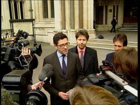 wins contempt ruling england london the strand kevin maxwell along from high court tcms maxwell with press around kevin maxwell speaking to press sot... - kevin maxwell stock videos & royalty-free footage