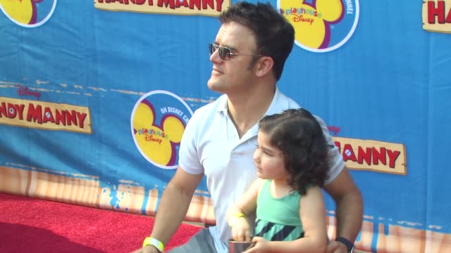 kevin weisman with daughter maya at the exclusive premiere of disney channel's 'handy manny motorcycle adventure' at hollywood ca - latin american civilizations stock videos and b-roll footage