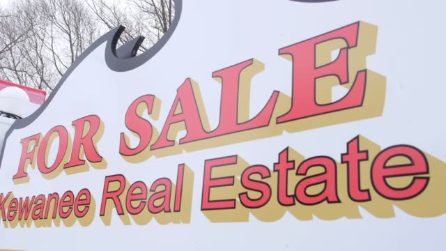 a kewanee real estate sign stands outside a foreclosed home for sale in princeton illinois us on wednesday jan 22 wide shot of a kewanee real estate... - real estate sign stock videos & royalty-free footage