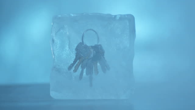 CU Key ring frozen in ice block.