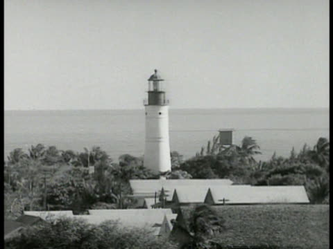 key west lighthouse xha ws key west neighborhood houses ws twostory house w/ surrounding porch sealed mounted historical cannons - key west stock videos & royalty-free footage