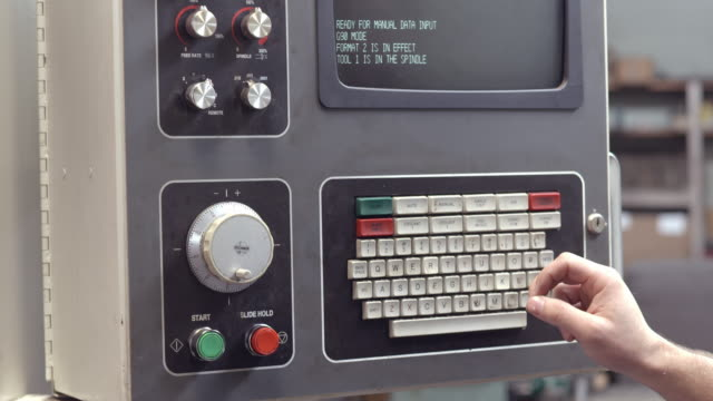 ecu of keyboard and computer screen display of industrial milling machine being manually programmed for metal grinding job / redlands, california, usa - manufacturing machinery stock videos & royalty-free footage