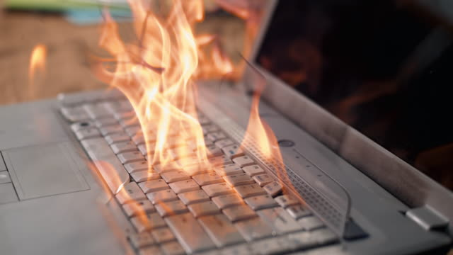 slo mo keyboard on laptop catching on fire - film tilt stock videos & royalty-free footage