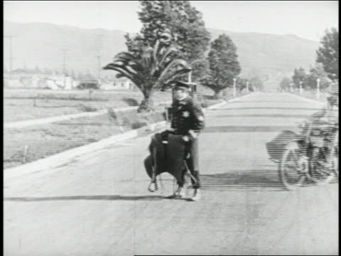 b/w 1924 keystone kop (will rogers) falling into sidecar as 2nd kop driving motorcycle hits him - sidecar stock videos & royalty-free footage
