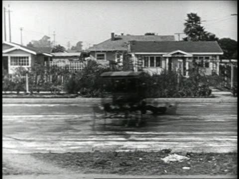 b/w 1924 keystone kop falling off back of skidding police truck on street / feature - 1924 stock videos & royalty-free footage