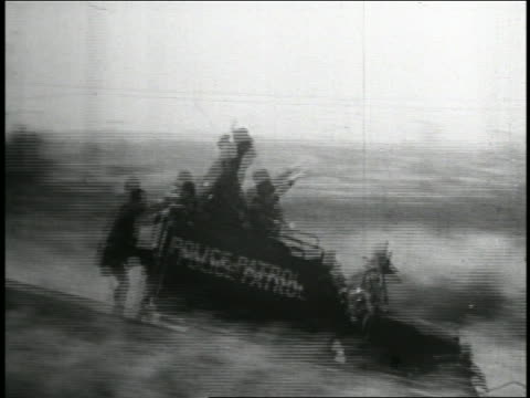 1935 b/w pan keystone kops in police truck driving on hilly road / feature - 1935 stock videos and b-roll footage
