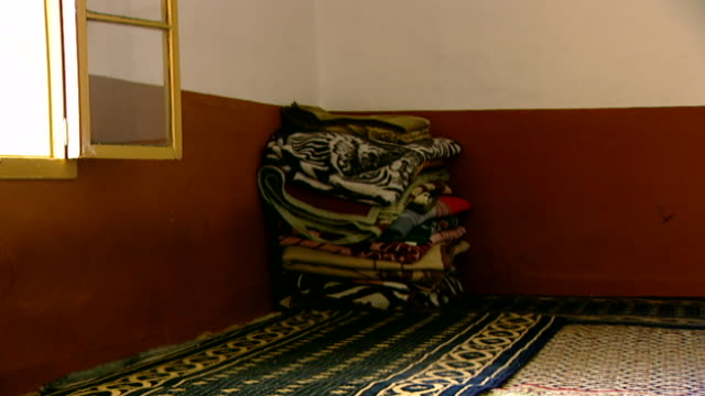 khalwat al-bayada. on a pile of sleeping blankets in the corner of a prayer room, in khalwat al-bayada, the central sanctuary and theological school... - theology stock videos & royalty-free footage