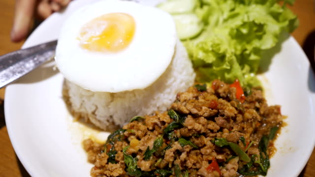 khao pad krapow (fried rice with basil leaves) thai street food. - fried rice stock videos and b-roll footage