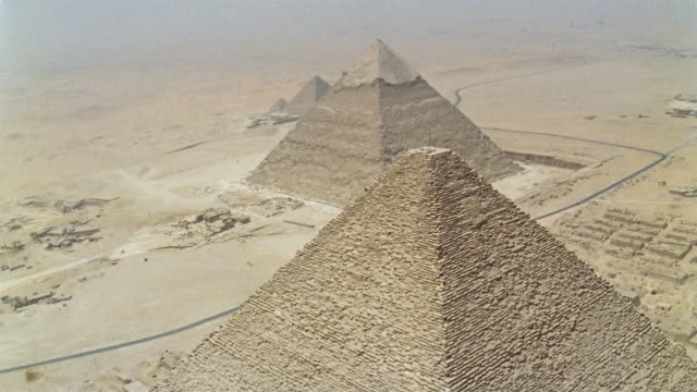 AERIAL WS Kheops Pyramid in foreground with Pyramid of Chephren behind / Giza, Egypt