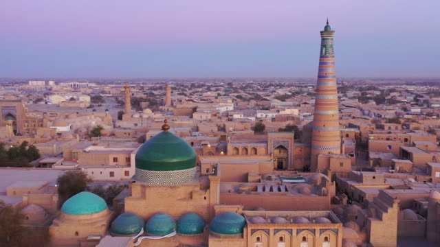 khiva uzbekistan sunset twilight islam khoja aerial 4k drone flight - temple building stock videos & royalty-free footage