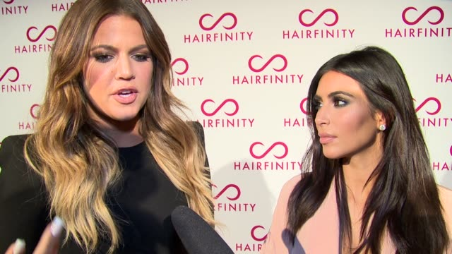 interview khloe kardashian and kim kardashian west on hair care styling and advice to youngsters at hairfinity uk launch party on 8th november 2014... - 2014 bildbanksvideor och videomaterial från bakom kulisserna