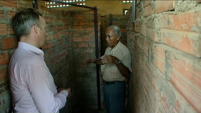 Khmer Rouge prison chief found guilty of crimes against humanity Security Prison 21 INT Chum Mey showing reporter prison cell he was detained in...