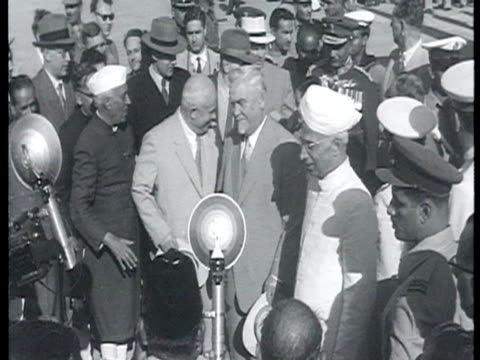 Khrushchev and Bulganin alight from plane welcomed by Nehru huge crowds state leaders in convertible car with parade in city streets / India AUDIO