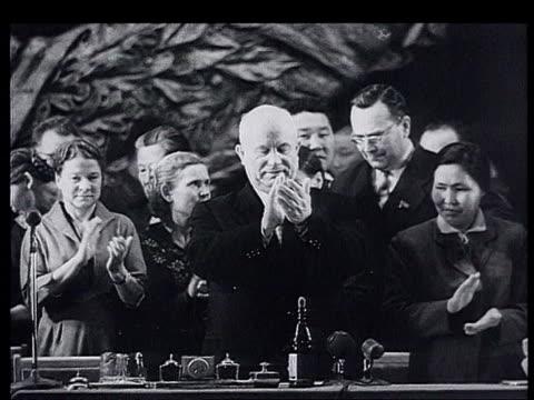 Khrushchev visits the Republics Novosibirsk Khrushchev deplane welcomed with bread and salt Khrushchev kisses the bread Khrushchev's praise vs of...