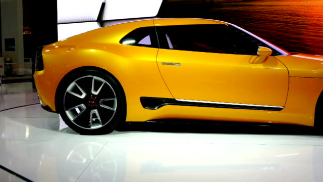 kia gt4 stinger in the canadian international autoshow which is canada's largest automotive show held annually at the metro toronto convention centre. - verkaufsargument stock-videos und b-roll-filmmaterial