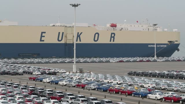 Kia Motors Corp vehicles bound for export await shipment as the Eukor Car Carriers Inc Morning Laura rollon/rolloff vehicles carrier cargo ship sits...