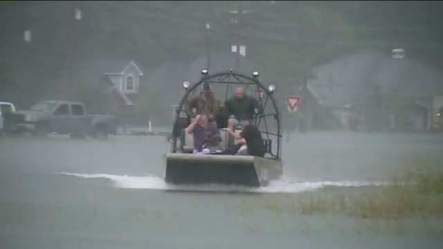 rescue team on airboat on street flooded by hurricane harvey - rescue stock videos & royalty-free footage