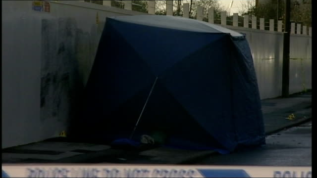 kiaran stapleton found guilty of anuj bidve murder; lib / day forensic tent at scene of shooting forensics officers unfolding tarpaulin sheet - 防水シート点の映像素材/bロール