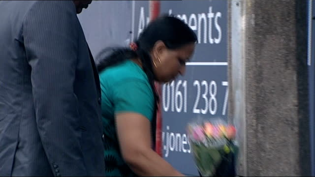 kiaran stapleton found guilty of anuj bidve murder; yogini bidve and subhash bidve leaving bouqet of flowers at scene of shooting - stapleton stock videos & royalty-free footage