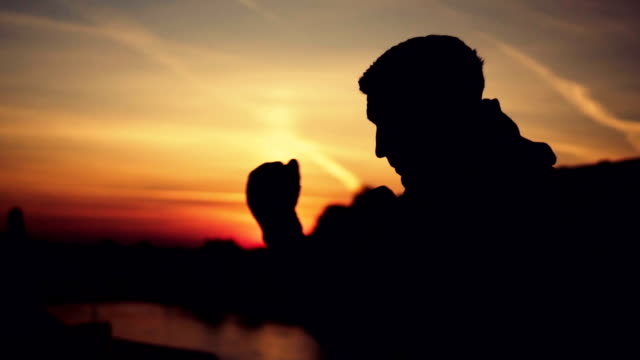 kick boxer shadow boxing at sunset - fighter stock videos and b-roll footage