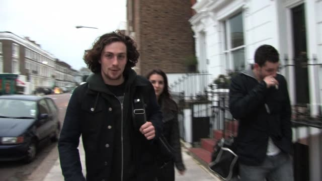 KickAss actor Aaron Johnson is spotted in Primrose Hill signing for a female fan Aaron and partner Sam TaylorWood have recently had their first child...