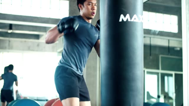 Kickboxer preparing for a fight at gym