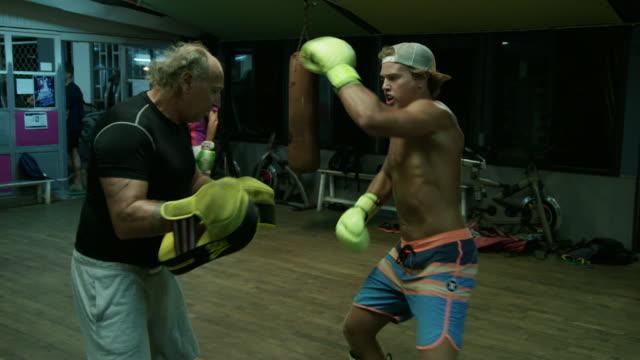 kickboxer spars in slow motion - kickboxing stock videos & royalty-free footage