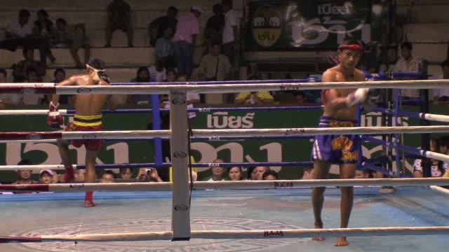ws zi cu kickboxers doing ritual preparation before fight, bangkok, thailand - kickboxing stock videos & royalty-free footage