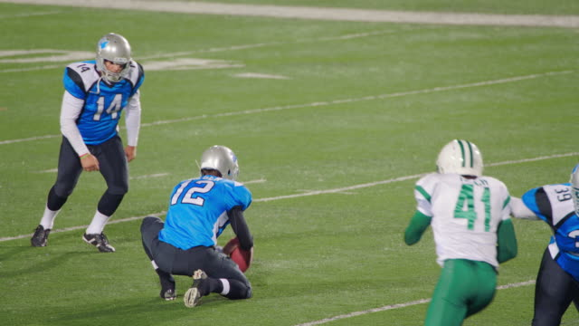 ms slo mo. kicker misses field goal attempt and defending team celebrates in professional football game. - american football ball stock videos & royalty-free footage