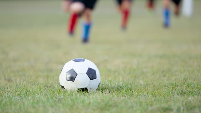 kicking a soccer ball - pitch stock videos & royalty-free footage