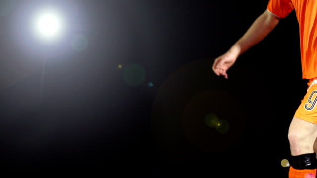kicking football / soccer ball, floodlights super slow motion, - soccer player stock videos and b-roll footage