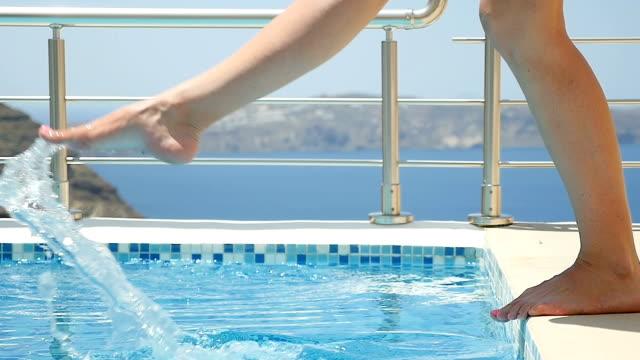 kicking & splashing the pool water - hot tub stock videos & royalty-free footage