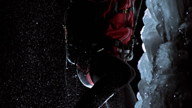 SLO MO kicking the ice slope with crampons