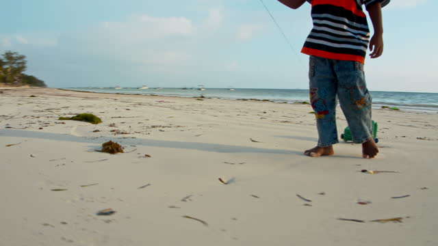 kid at the beach on december 24, 2019. - barefoot stock videos & royalty-free footage
