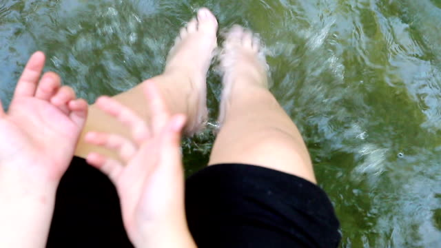kid dabbling legs in river - skinny dipping stock videos & royalty-free footage