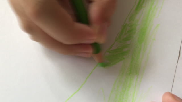 kid drawing abstract art in green - crayon stock videos and b-roll footage