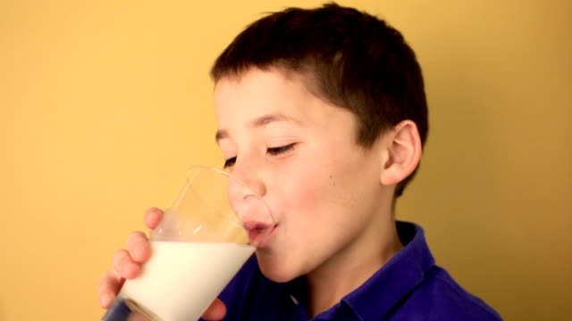 kid drinking glass of milk - milk stock videos & royalty-free footage