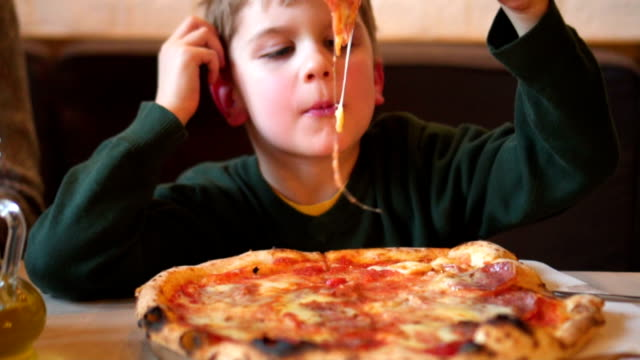 kid eating pizza - pizza stock videos & royalty-free footage