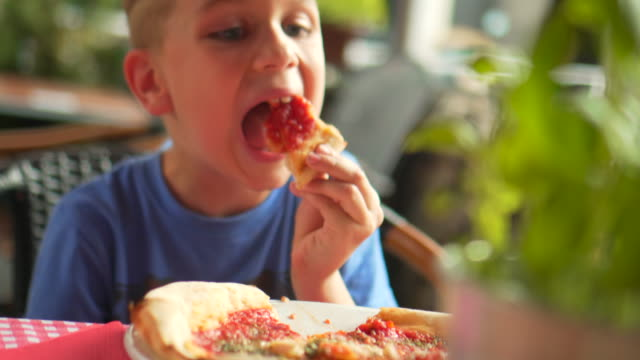 kid eating slice of pizza - ketchup stock videos and b-roll footage