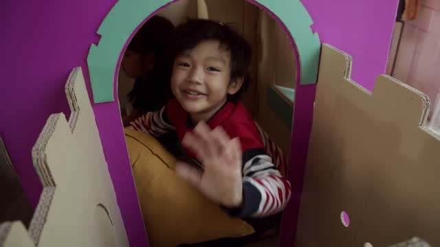 kid enjoy funny to play paper toy in christmas - castle stock videos & royalty-free footage