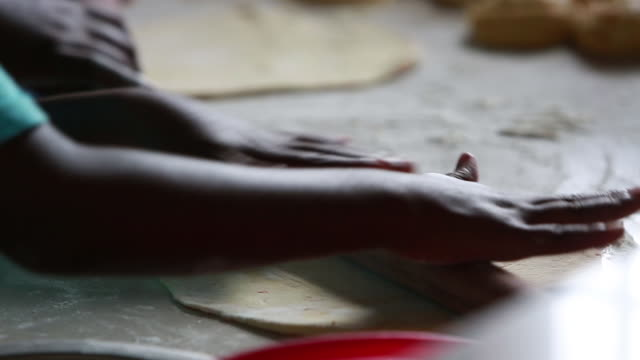 kid hands rolling out dough cu in tanzania - wiese stock videos & royalty-free footage