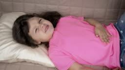 Kid having stomachache.